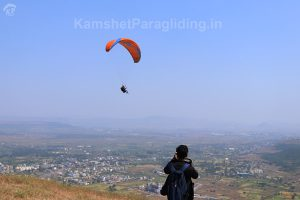 boy clicks photo of paragliding